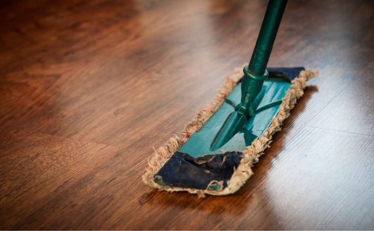 Mop Showing Water Resistant Hardwood Flooring