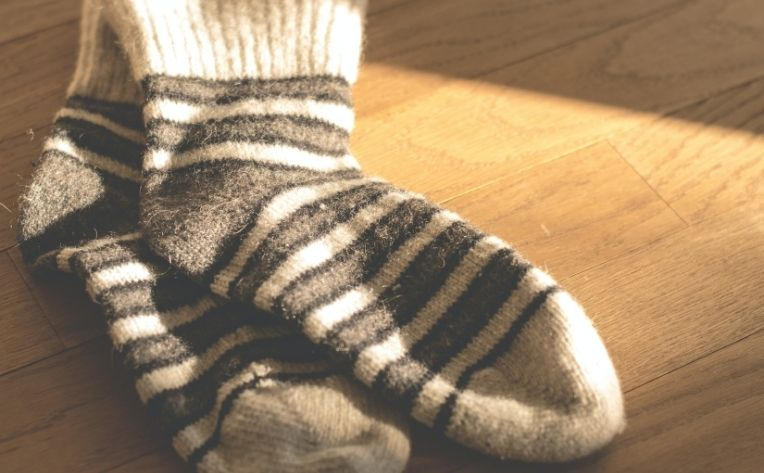Socks Lying on Clean Hardwood Flooring